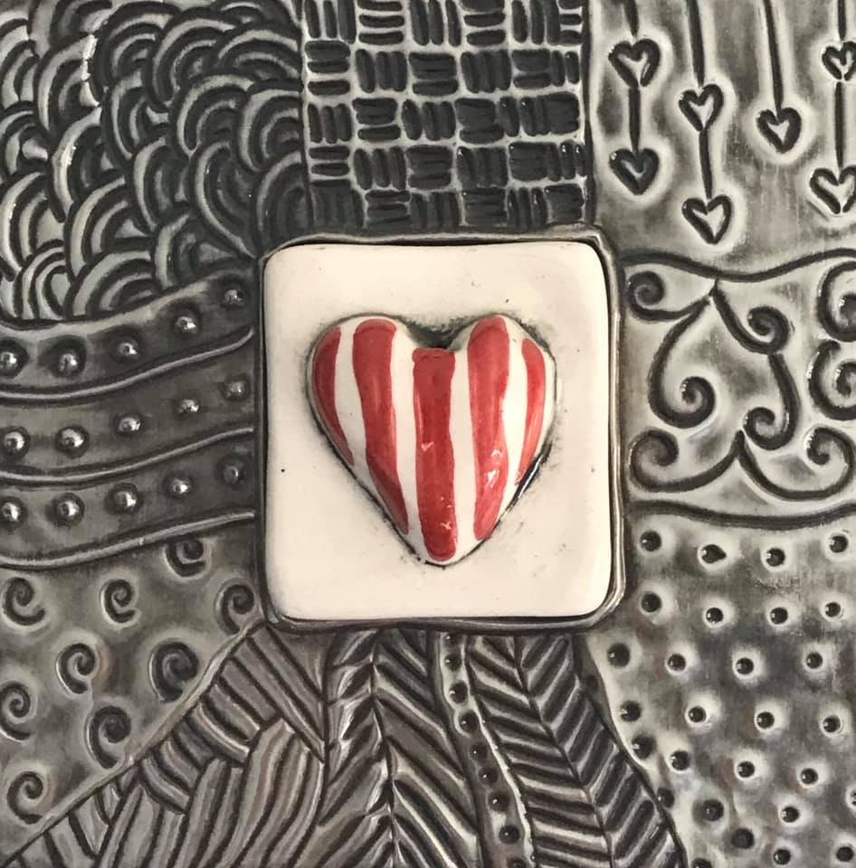 Ceramic heart on pewter. Engraved zentangle detail on the pewter