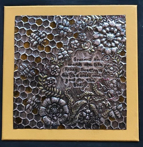 Bee-themed embossed aluminium artwork, made by Theresa