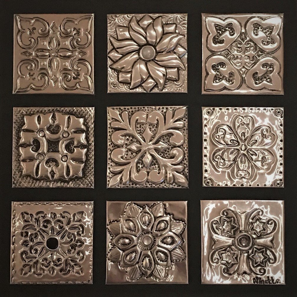 A sample block of the different techniques used in metal embossing.