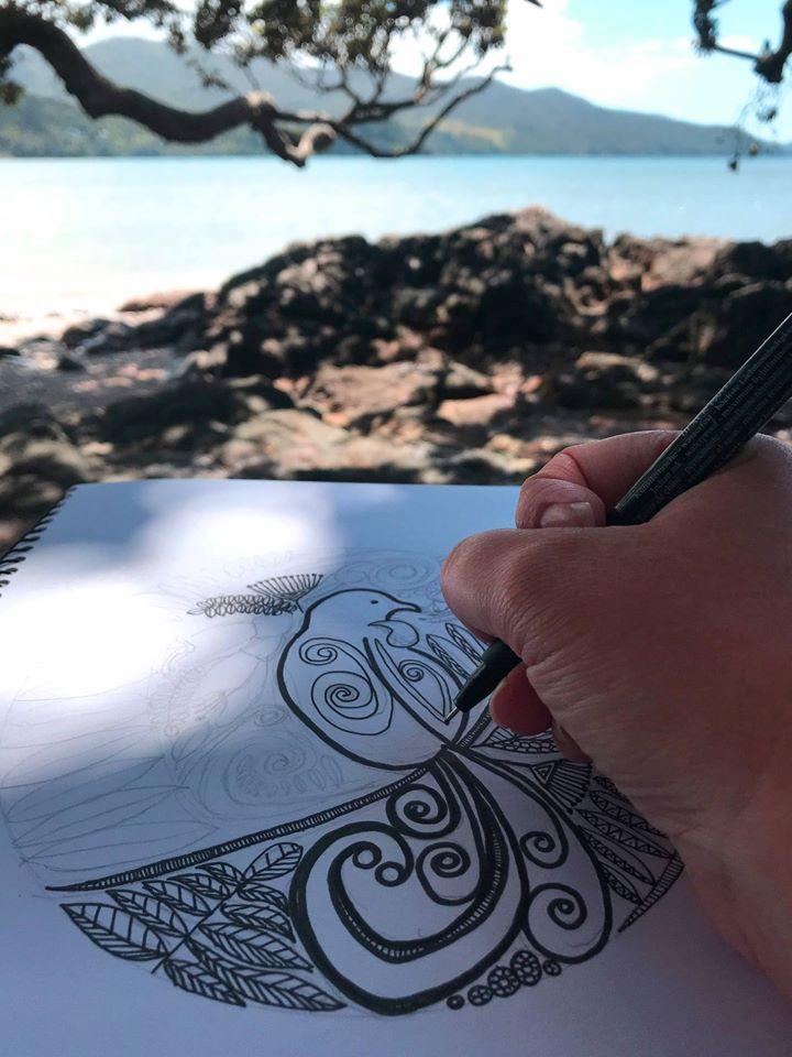 Artist Anna Mollekin drawing her distinct lines and patterns